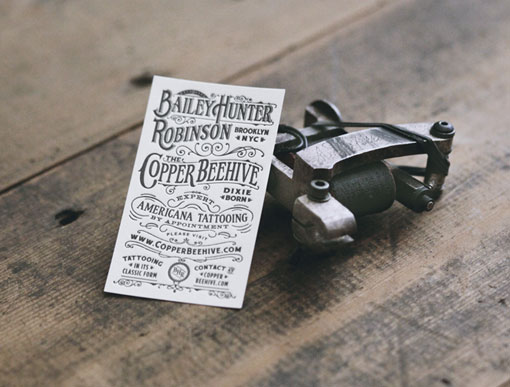 Two arms expert americana tattooing business cards for Business card size tattoos